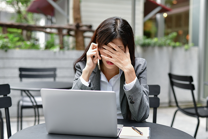 Stressed Woman Looking at Computer